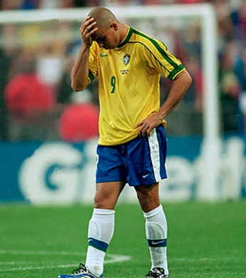 Brazil's Ronaldo (right) holds his head in disappointment after the match